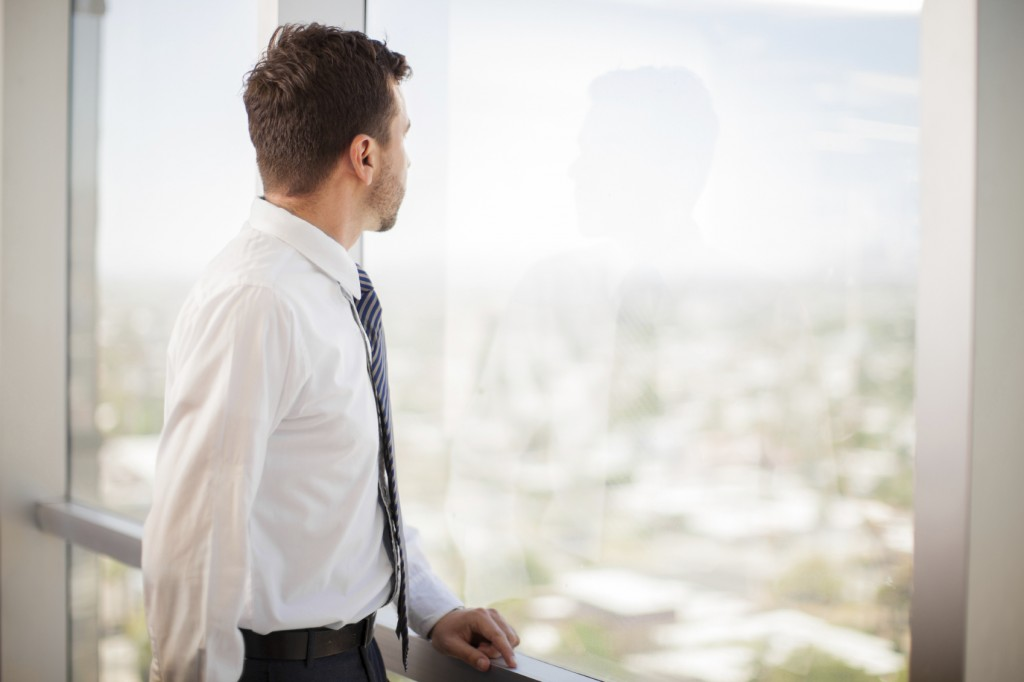 Businessman looking at a window