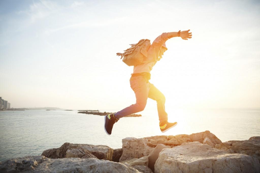 traveler running at sunset