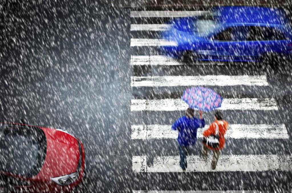 pedestrian crossing in the heavy snowfall