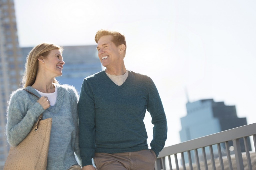 Happy couple looking at each other in city