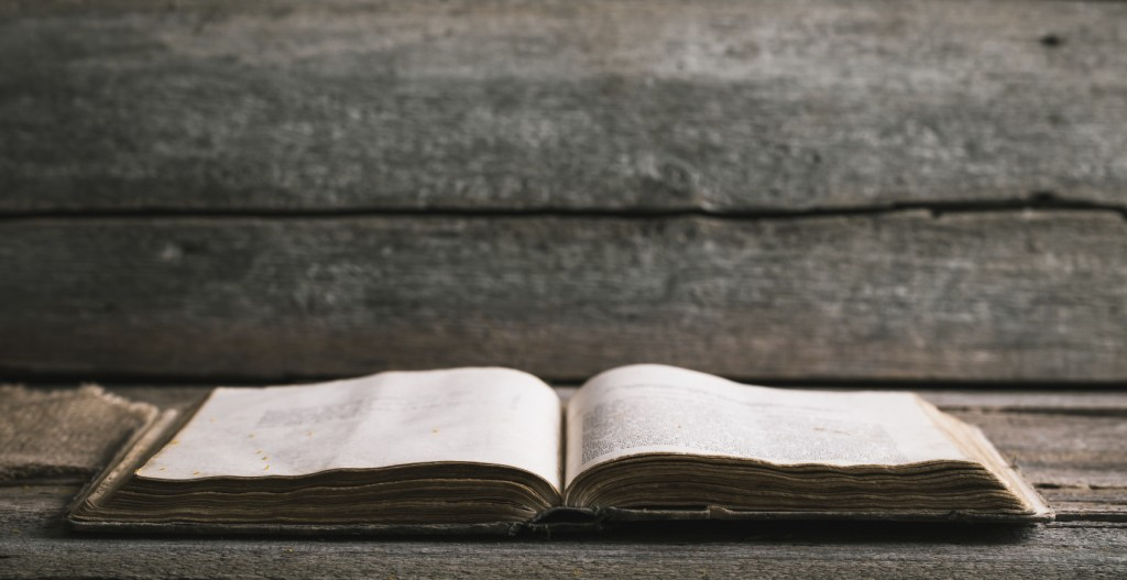 An old Bible on an old wooden background