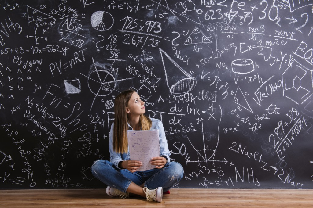 Student in front of blackboard