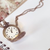 Vintage pocket watch on books.