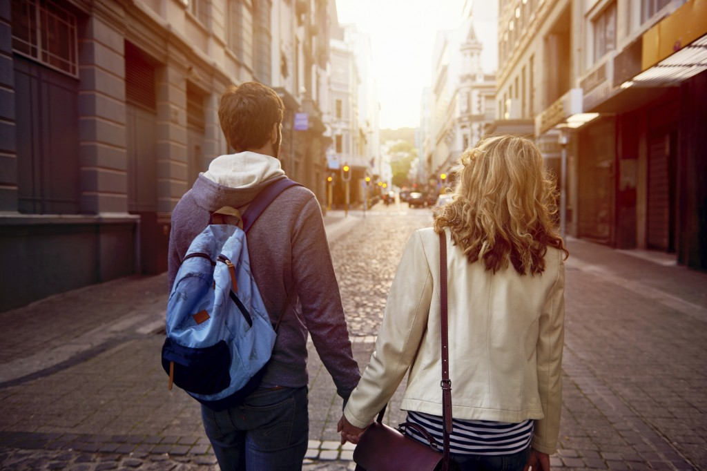 couple walking street on vacation together