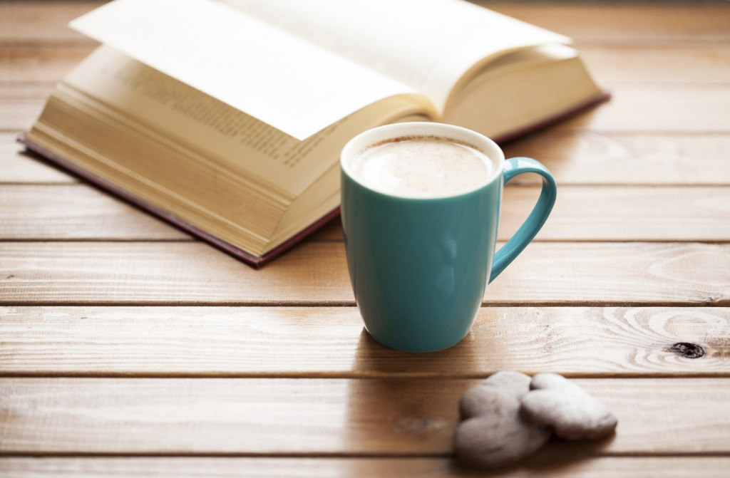 Coffee with cookies and book