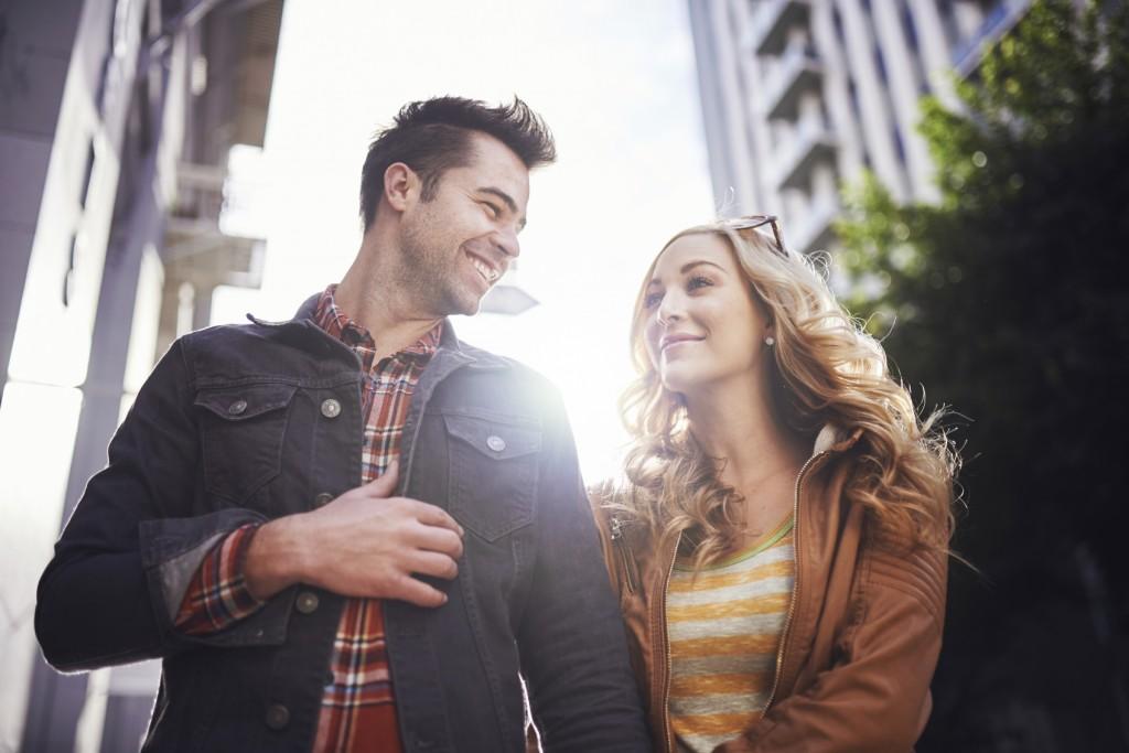 romantic couple walking through downtown l