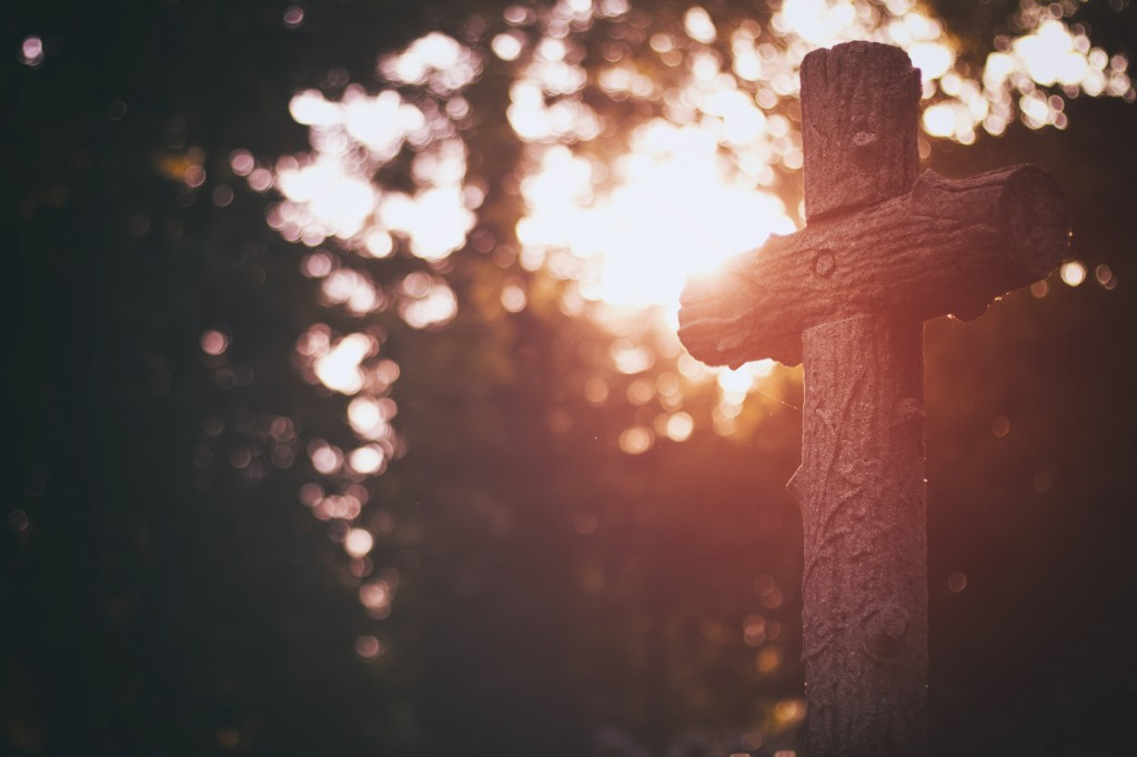 Old wooden cross in the cementery