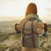 Hiker woman walking outdoor at sunset