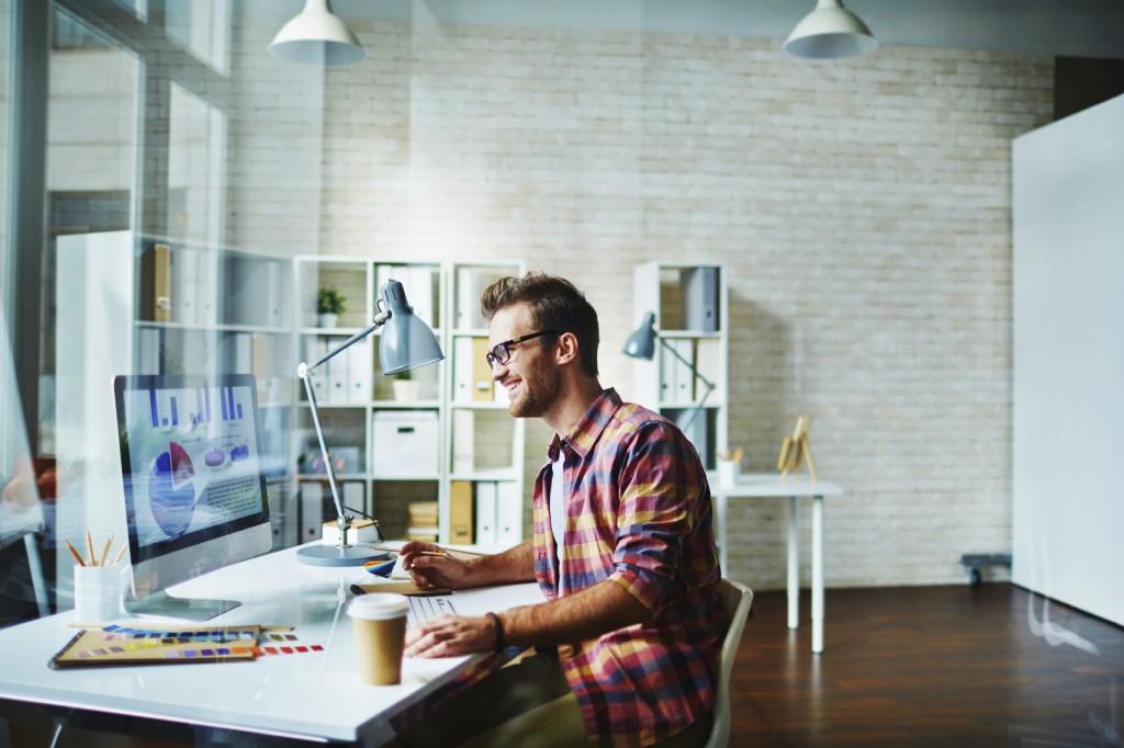 Designer at work at the computer at his office