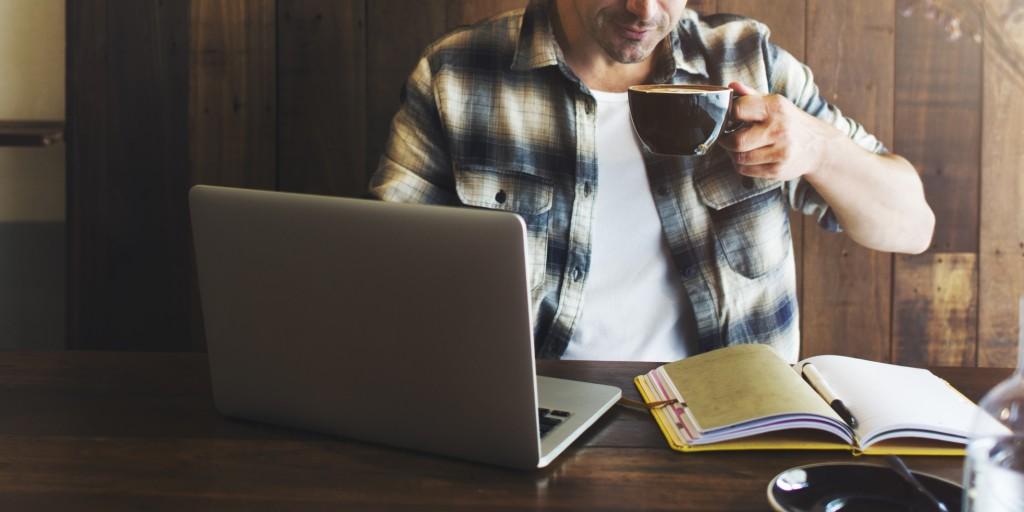 Man reading in coffee shop