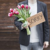Man saying sorry with flowers