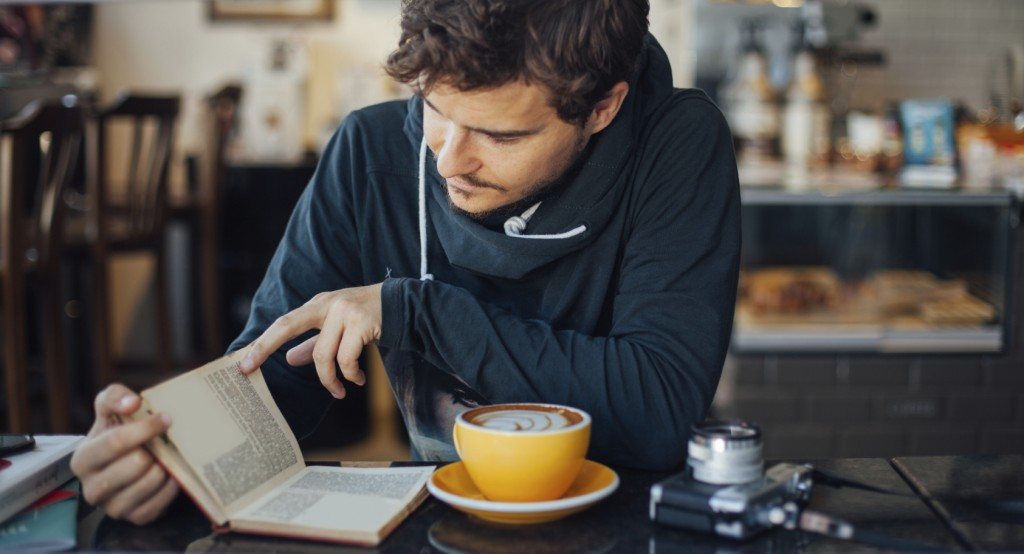 Man reading at a coffee shop