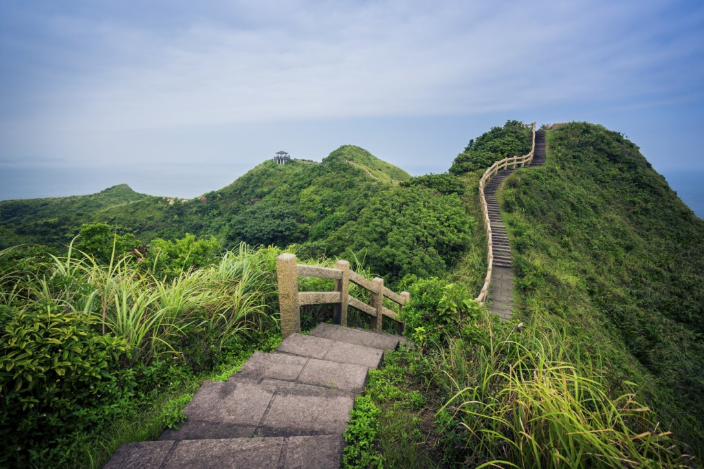 Path over green hills