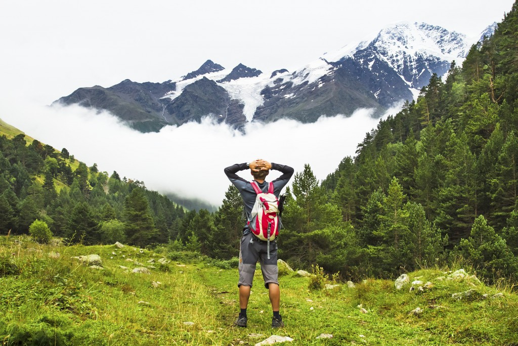 The man travels in mountains