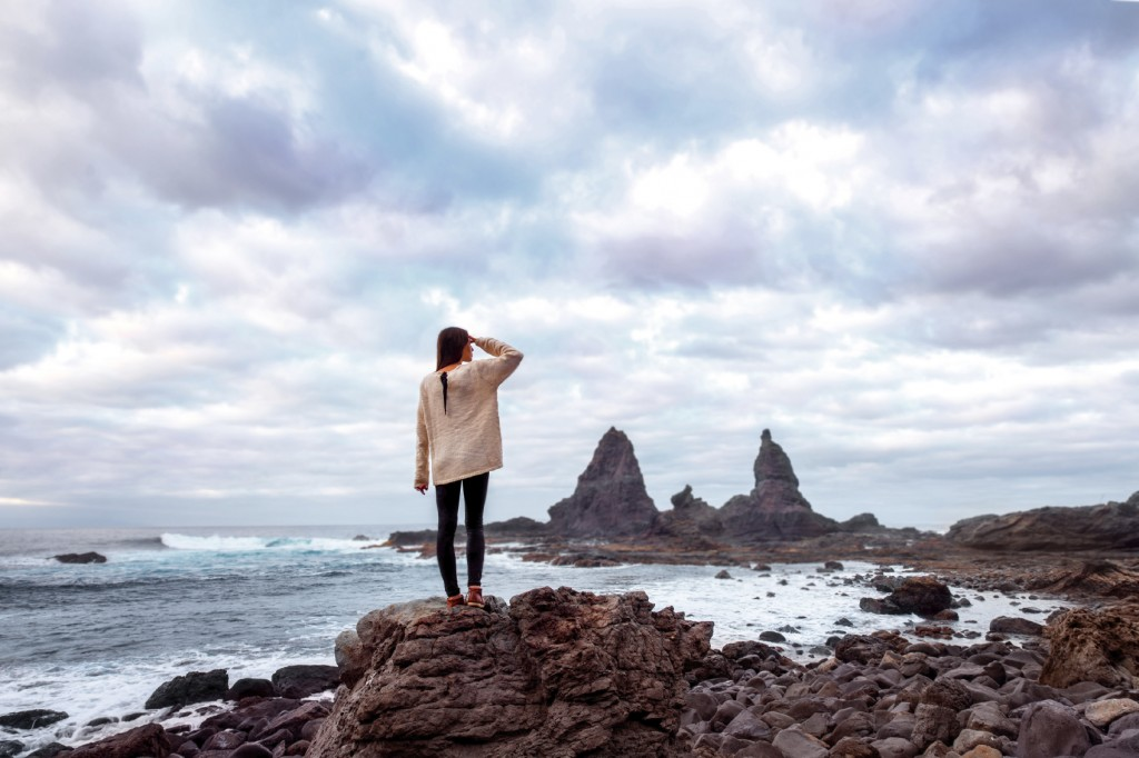 Woman on the rocky coast