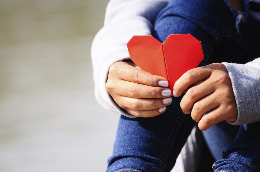 Hands Holding a Red Heart Shape
