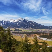 anoramic view of Reutte with Alps and clouds