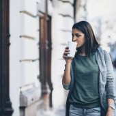 Teenage girl going shopping with take-away coffee