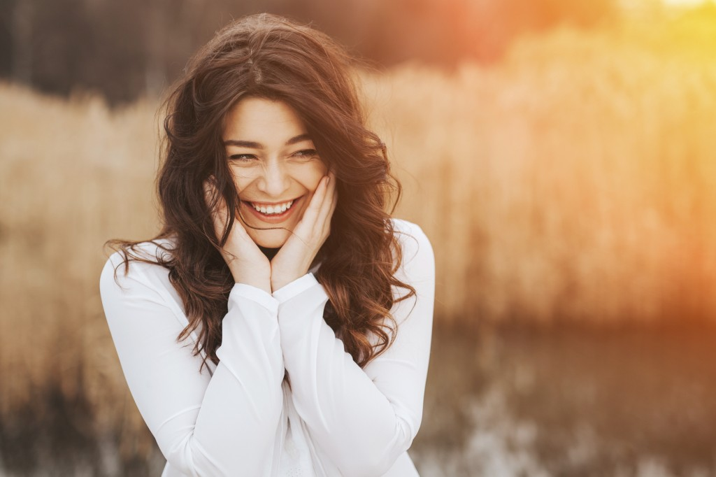 Face laughing woman outdoors