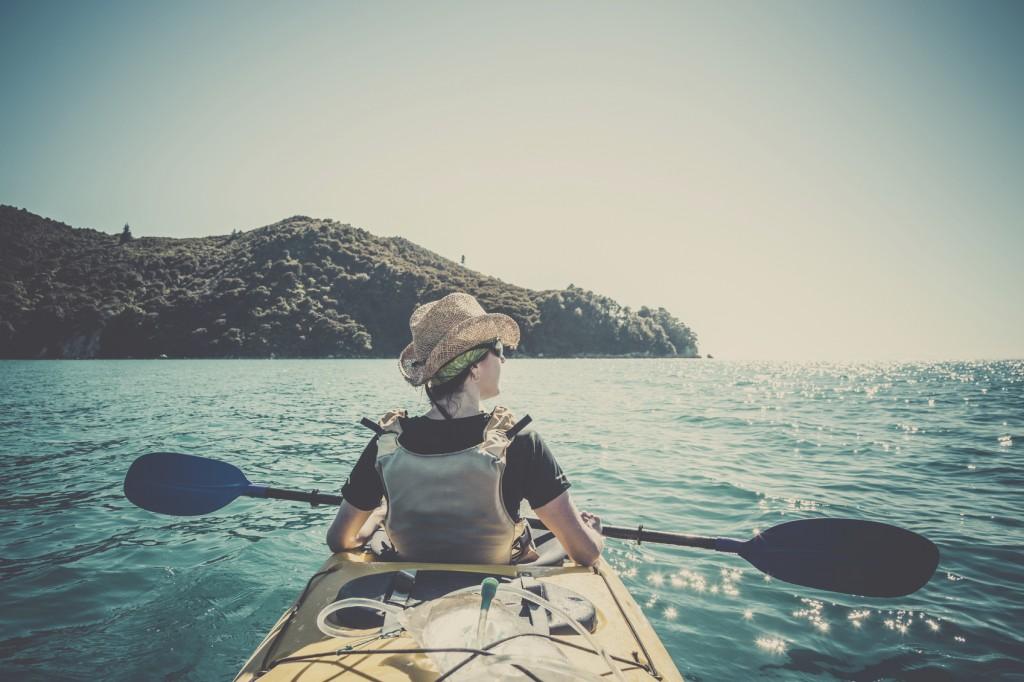 Woman Kayaking in Abel Tasman National Park, New Zealand