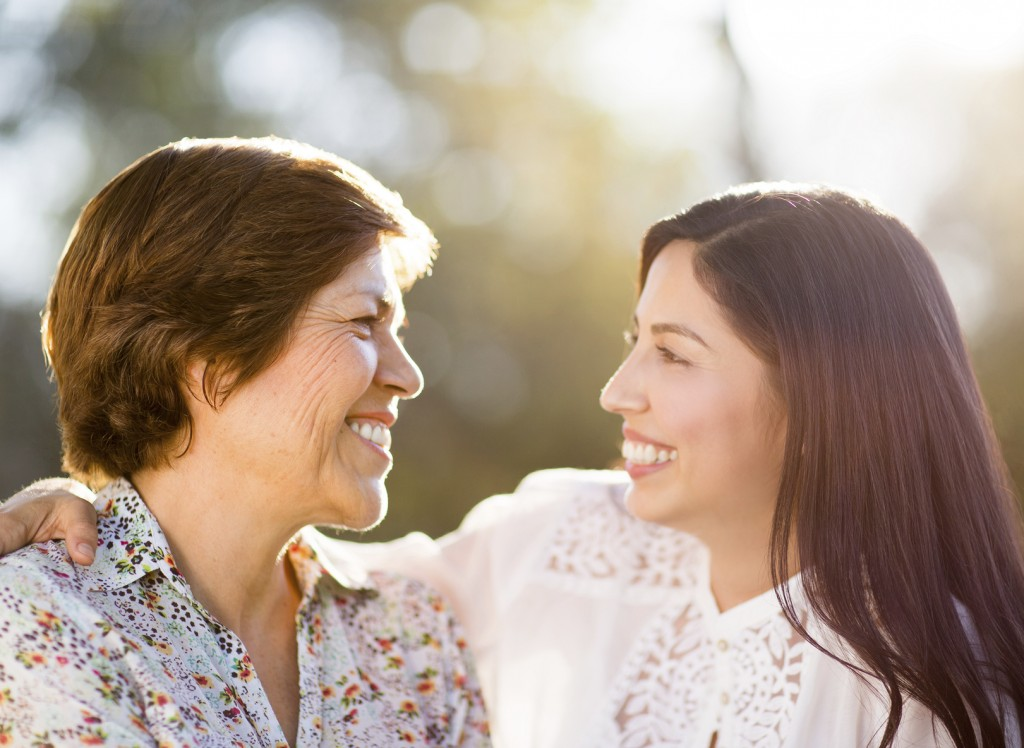 Loving mother and daughter smiling at each other