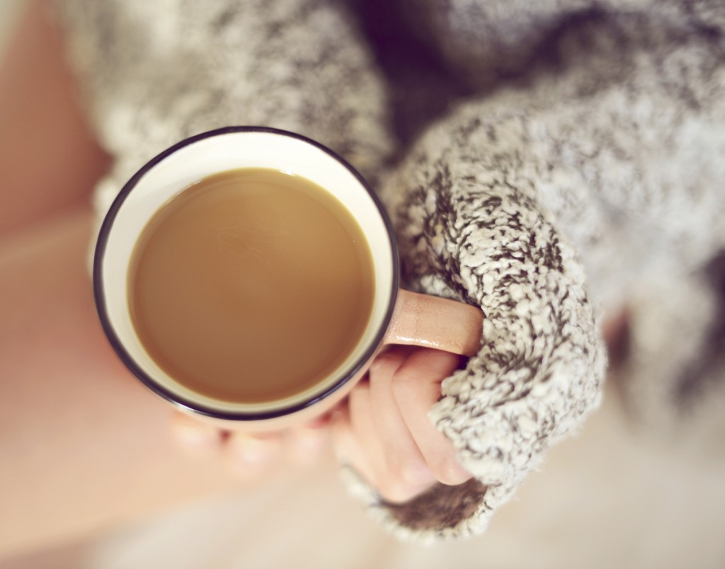 woman's hands holding a cup of coffee close-up