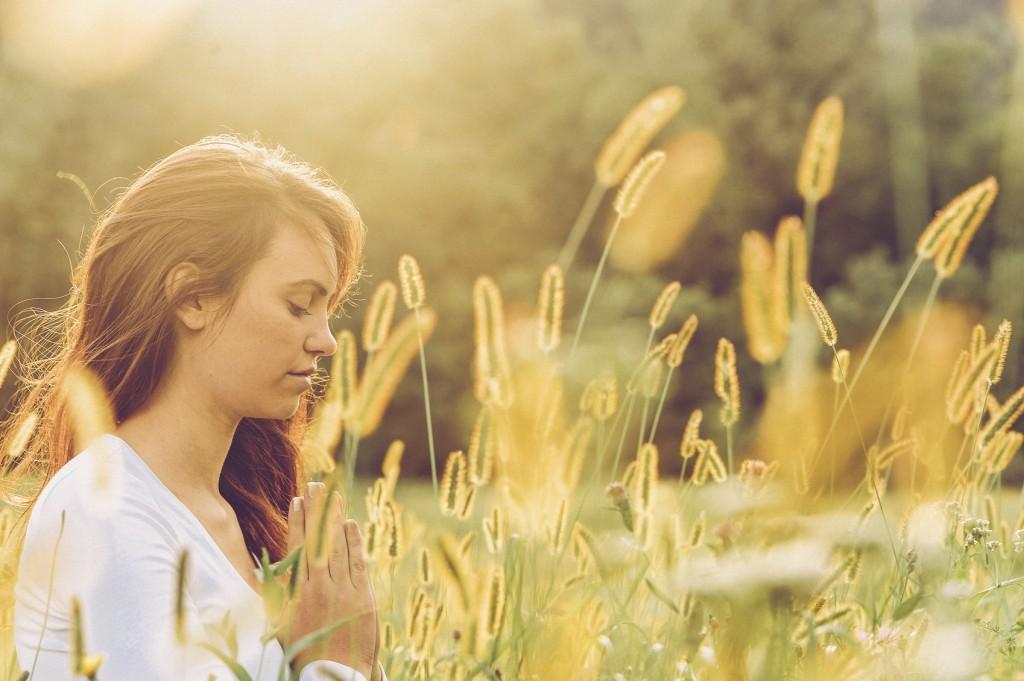 Young Woman Prayin Outdoors