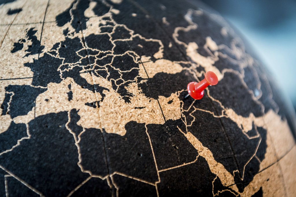 world globe with a tack in Syria