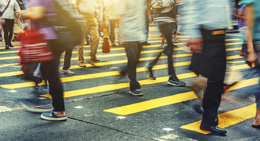Pedestrians crossing Nathan Road in Hong Kong, China