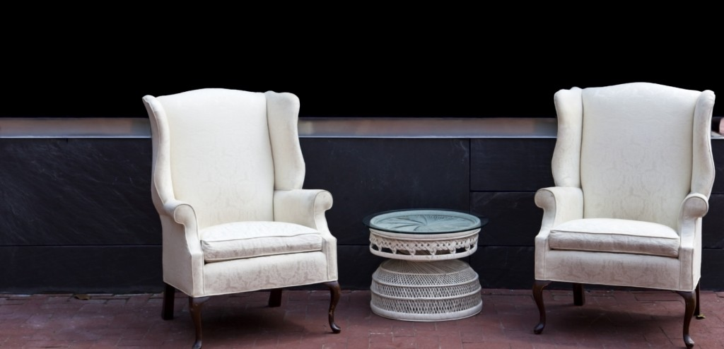 Two wing chairs outdoors on brick patio
