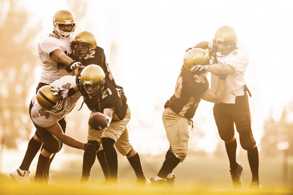 American football players in action on the playing field.