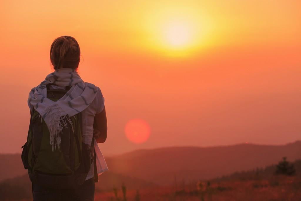 Sunset mountain landscape Women hiker enjoying in the great view