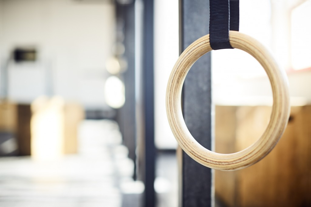 Close-up of gymnastic ring hanging in gym