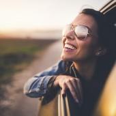 Beautiful woman on road trip in car