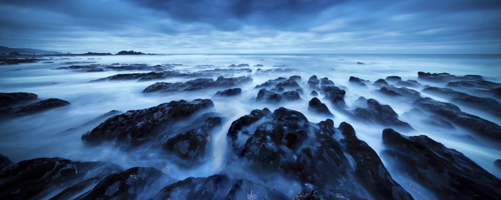 A super wide angle shot of rocks along the rugged west coast of New Zealand, near Punakaiki.