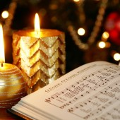 Christmas carol Detail of songbook with Christmas carols and Christmas decorations.