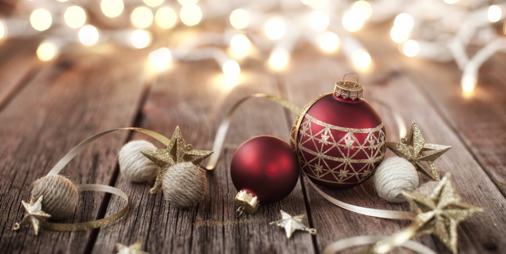 Christmas Baubles with Ribbon and Stars on Old Wood Background