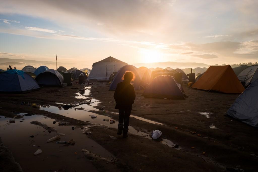 Refugee kid among tents