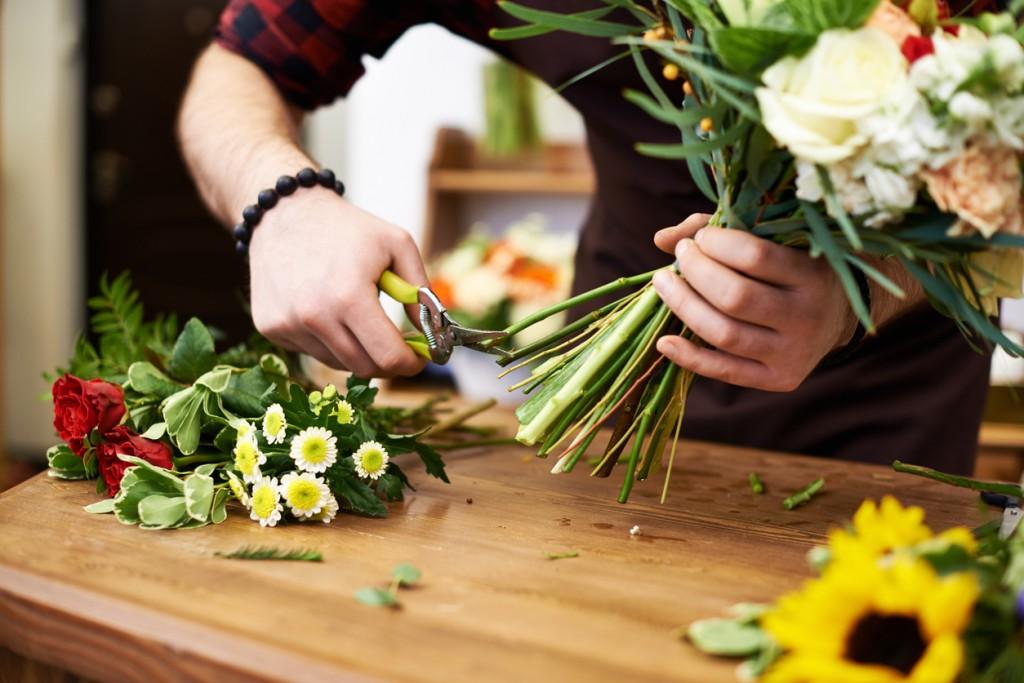 Floral designer cutting flower stems