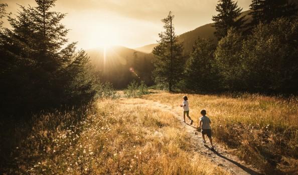 Kids running towards the sun