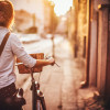 Young woman is doing her business chores on the bicycle around the city;