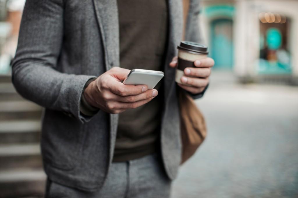 Businessman using smart phone