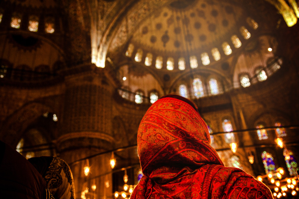 Woman praying inside a mosque in Istanbul, Turkey.