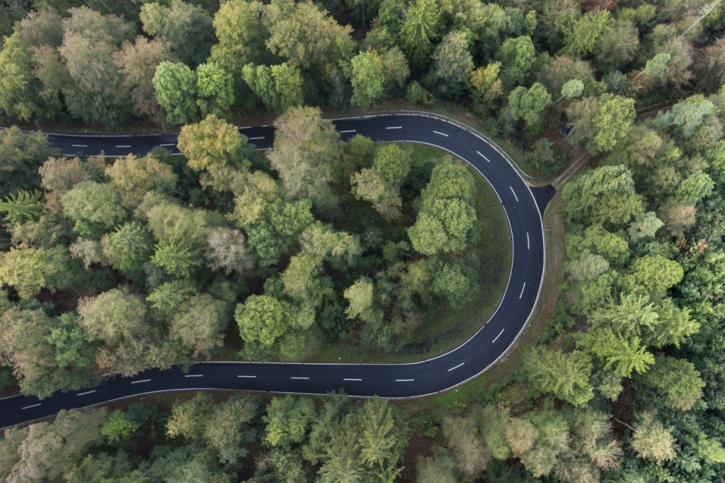 Road curve in the forest aerial view