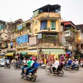 Busy street corner in old town Hanoi Vietnam