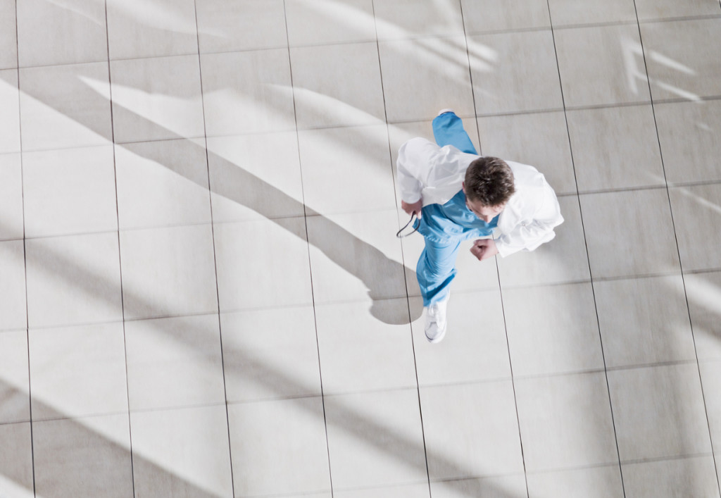 Doctor running through hospital lobby