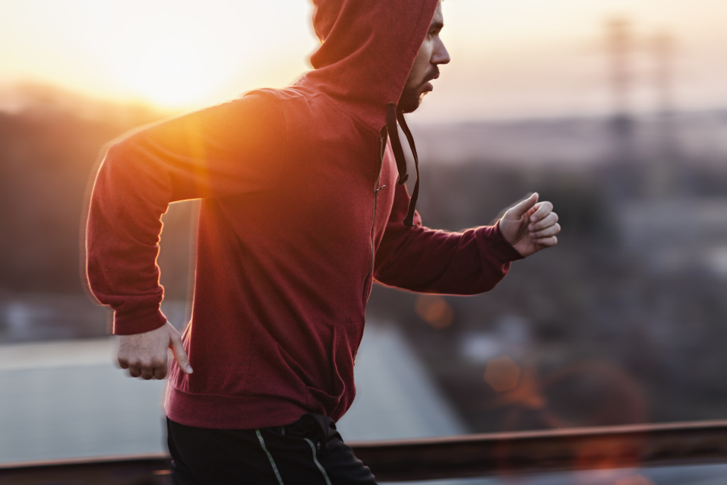 a man running while sun is setting