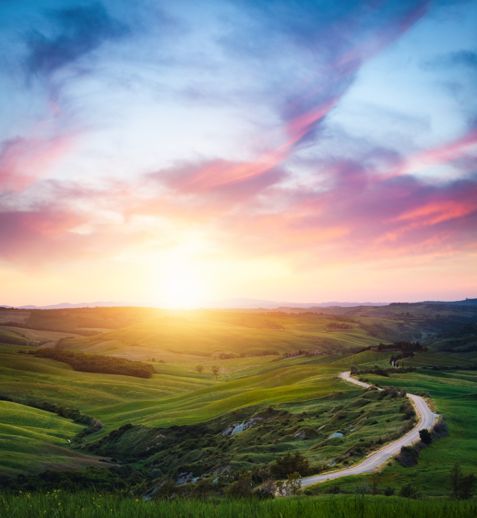 Tuscany landscape with winding country road at sunset (Val D'orcia, Italy).