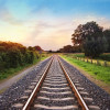 railway tracks in a rural scene with nice pastel sunset