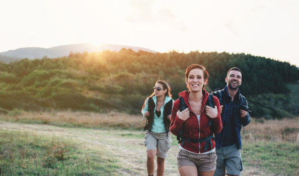 Portrait of backpackers at sunset